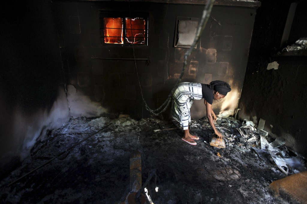 A woman picks through the ruins of her apartment torched by Islamic militants in Maiduguri