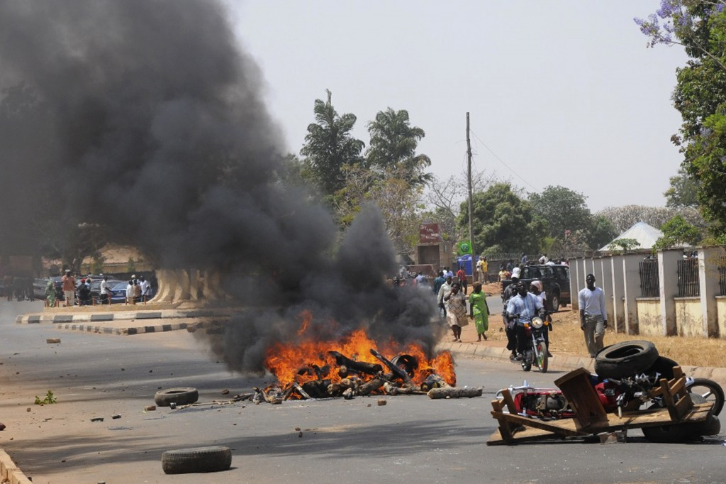 A roadblock burns after the bombing of a church in Nigeria