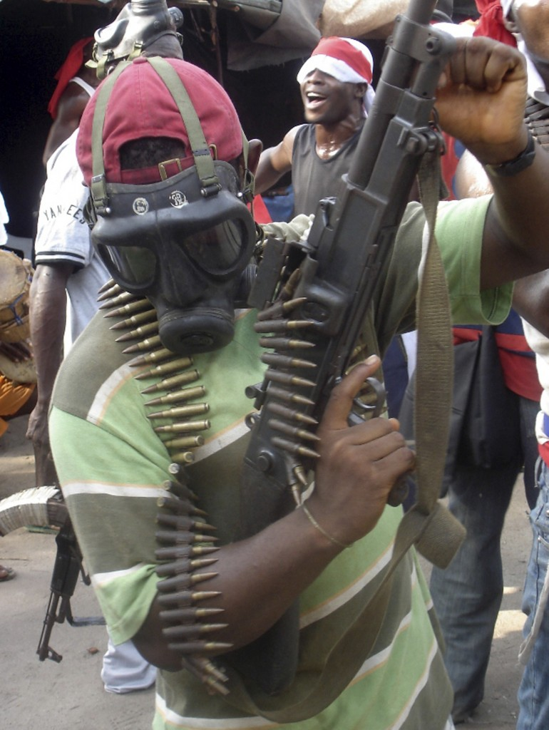 Fighter loyal to militant leader Ateke Tom shows off his weapon in one of their camps in the Niger Delta