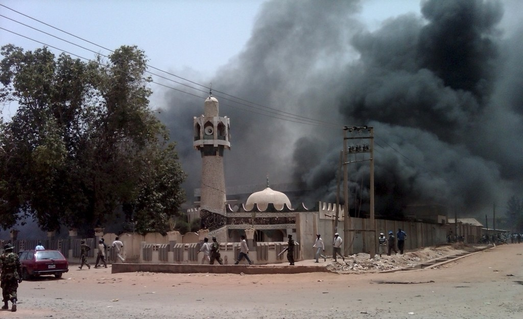 A mosque is set on fire by protesters after the release of the presidential elections results in Kano
