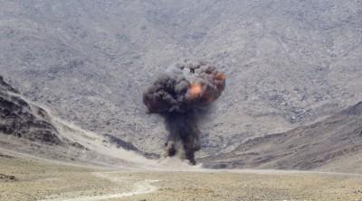 U.S. Air Force explosives ordinance disposal (EOD) specialists living on and working out of forward operating base (FOB) Mehtarlam located in Afghanistan's Laghman Province, conduct a controlled detonation on Saturday, Sept. 1, 2007, to destroy approximately 900 pounds of small arms ammunition, rocket propelled grenades and mortars turned in by provincial citizens under the small arms for rewards program. (U.S. Air Force photo/Master Sgt. Jim Varhegyi)(released)