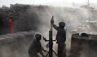 """""""Soldiers Lay Down Mortar Fire in Afghanistan"""" by DVIDSHUB is licensed with CC BY 2.0."""